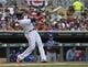 Sep 22, 2019; Minneapolis, MN, USA;  Minnesota Twins designated hitter Nelson Cruz (23) hits a single during the first inning against the Kansas City Royals at Target Field. Mandatory Credit: Marilyn Indahl-USA TODAY Sports