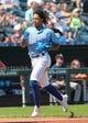 Sep 15, 2019; Kansas City, MO, USA; Kansas City Royals shortstop Adalberto Mondesi  (27) scores against the Houston Astros at Kauffman Stadium. Mandatory Credit: Jay Biggerstaff-USA TODAY Sports