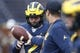Sep 28, 2019; Ann Arbor, MI, USA; Michigan Wolverines quarterback Shea Patterson (2) receives a ball from head coach Jim Harbaugh before the game against the Rutgers Scarlet Knights at Michigan Stadium. Mandatory Credit: Raj Mehta-USA TODAY Sports