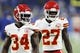 Sep 29, 2019; Detroit, MI, USA; Kansas City Chiefs running back Darwin Thompson (34) and defensive back Rashad Fenton (27) prepare to warm up before the game against the Detroit Lions at Ford Field. Mandatory Credit: Raj Mehta-USA TODAY Sports