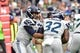 Sep 29, 2019; Glendale, AZ, USA; Seattle Seahawks quarterback Russell Wilson (3) hands off to running back Chris Carson (32) during the first half against the Arizona Cardinals at State Farm Stadium. Mandatory Credit: Matt Kartozian-USA TODAY Sports