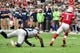 Sep 29, 2019; Glendale, AZ, USA; Arizona Cardinals quarterback Kyler Murray (1) escapes a tackle by Seattle Seahawks outside linebacker Jadeveon Clowney (90) in the first half at State Farm Stadium. Mandatory Credit: Matt Kartozian-USA TODAY Sports