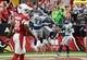 Sep 29, 2019; Glendale, AZ, USA; Seattle Seahawks outside linebacker Jadeveon Clowney  celebrates an interception return for a touchdown against the Arizona Cardinals during the first half at State Farm Stadium. Mandatory Credit: Joe Camporeale-USA TODAY Sports