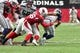 Sep 29, 2019; Glendale, AZ, USA; Seattle Seahawks quarterback Russell Wilson (3) is sacked by Arizona Cardinals outside linebacker Terrell Suggs (56) and middle linebacker Jordan Hicks (58) during the second half at State Farm Stadium. Mandatory Credit: Matt Kartozian-USA TODAY Sports