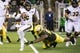 Oct 5, 2019; Eugene, OR, USA; California Golden Bears quarterback Devon Modster (6) is chased out of the pocket by an Oregon Ducks defender during the second half at Autzen Stadium. Oregon won the game 17-7. Mandatory Credit: Troy Wayrynen-USA TODAY Sports