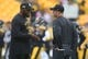 Oct 6, 2019; Pittsburgh, PA, USA;  Pittsburgh Steelers head coach Mike Tomlin (left) and Baltimore Ravens head coach John Harbaugh (right) talk at mid-field before their teams play at Heinz Field. Mandatory Credit: Charles LeClaire-USA TODAY Sports