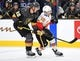 Oct 12, 2019; Las Vegas, NV, USA; Calgary Flames center Derek Ryan (10) and Vegas Golden Knights defenseman Nick Holden (22) skate towards the puck during the first period at T-Mobile Arena. Mandatory Credit: Stephen R. Sylvanie-USA TODAY Sports