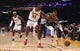 Oct 16, 2019; Los Angeles, CA, USA; Golden State Warriors guard D'Angelo Russell (0) is defended by Los Angeles Lakers center Dwight Howard (39) and guard Kentavious Caldwell-Pope (1)  in the first half at Staples Center. Mandatory Credit: Kirby Lee-USA TODAY Sports
