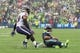 Oct 20, 2019; Seattle, WA, USA; Seattle Seahawks quarterback Russell Wilson (3) slides before getting tackled by Baltimore Ravens free safety Earl Thomas (29) during the first half at CenturyLink Field. Mandatory Credit: Steven Bisig-USA TODAY Sports