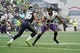 Oct 20, 2019; Seattle, WA, USA; Baltimore Ravens cornerback Marcus Peters (24) defends against Seattle Seahawks wide receiver Tyler Lockett (16) at CenturyLink Field. Mandatory Credit: Kirby Lee-USA TODAY Sports
