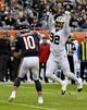 Oct 20, 2019; Chicago, IL, USA; Chicago Bears quarterback Mitchell Trubisky (10) is pressured by New Orleans Saints defensive end Marcus Davenport (92) during the first half at Soldier Field. Mandatory Credit: Matt Marton-USA TODAY Sports