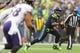 Oct 20, 2019; Seattle, WA, USA; Seattle Seahawks quarterback Russell Wilson (3) carries the ball against the Baltimore Ravens during the first half at CenturyLink Field. Baltimore defeated Seattle 30-16. Mandatory Credit: Steven Bisig-USA TODAY Sports