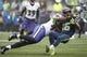 Oct 20, 2019; Seattle, WA, USA; Seattle Seahawks wide receiver Tyler Lockett (16) is tackled by Baltimore Ravens linebacker Jaylon Ferguson (45) during the second quarter at CenturyLink Field. Mandatory Credit: Joe Nicholson-USA TODAY Sports