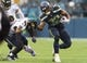 Oct 20, 2019; Seattle, WA, USA; Seattle Seahawks running back Chris Carson (32) stiff arms Baltimore Ravens free safety Earl Thomas (29) during the second half at CenturyLink Field. Baltimore defeated Seattle 30-16. Mandatory Credit: Steven Bisig-USA TODAY Sports