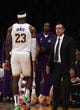 Oct 16, 2019; Los Angeles, CA, USA; Los Angeles Lakers coach Frank Vogel (right) watches as forward LeBron James (23) walks to the bench in the first half against the Golden State Warriors at Staples Center. The Lakers defeated the Warriors 126-93. Mandatory Credit: Kirby Lee-USA TODAY Sports