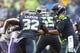 Oct 20, 2019; Seattle, WA, USA; Seattle Seahawks quarterback Russell Wilson (3) hands the ball off to Seattle Seahawks running back Chris Carson (32) during the first half at CenturyLink Field. Baltimore defeated Seattle 30-16. Mandatory Credit: Steven Bisig-USA TODAY Sports