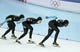 Feb 21, 2014; Sochi, RUSSIA; (Left to right) Jonathan Kuck, Brian Hansen, and Shani Davis all of the USA, skate in the Speed Skating men's team pursuit quarterfinals during the Sochi 2014 Olympic Winter Games at Adler Arena Skating Center. Mandatory Credit: Jeff Swinger-USA TODAY Sports