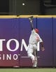 Jul 7, 2014; Milwaukee, WI, USA;   Philadelphia Phillies right fielder Marlon Byrd (3) makes a running catch of a ball hit by Milwaukee Brewers right fielder Ryan Braun (not pictured) in the first inning at Miller Park. Mandatory Credit: Benny Sieu-USA TODAY Sports