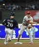 Jul 7, 2014; Milwaukee, WI, USA;  Philadelphia Phillies second baseman Chase Utley (26) completes a double play after forcing out Milwaukee Brewers catcher Jonathan Lucroy (20) in the fourth inning at Miller Park. Mandatory Credit: Benny Sieu-USA TODAY Sports