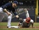 Jul 7, 2014; Milwaukee, WI, USA;   Philadelphia Phillies center fielder Ben Revere (2) gets back to first base before the tag by Milwaukee Brewers first baseman Mark Reynolds (7) on a pickoff attempt in the fifth inning at Miller Park. Mandatory Credit: Benny Sieu-USA TODAY Sports