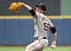 Aug 5, 2014; Milwaukee, WI, USA;  San Francisco Giants pitcher Tim Lincecum (55) pitches in the first inning against the Milwaukee Brewers at Miller Park. Mandatory Credit: Benny Sieu-USA TODAY Sports