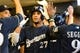 Aug 5, 2014; Milwaukee, WI, USA; Milwaukee Brewers center fielder Carlos Gomez (27) celebrates with teammates in the dugout after hitting a 2-run homer in the third inning against the San Francisco Giants at Miller Park. Mandatory Credit: Benny Sieu-USA TODAY Sports