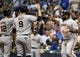 Aug 5, 2014; Milwaukee, WI, USA; San Francisco Giants third baseman Pablo Sandoval (48) celebrates with second baseman Joe Panik (12) and right fielder Hunter Pence (8) after hitting a 3-run homer in the sixth inning against the Milwaukee Brewers at Miller Park. Mandatory Credit: Benny Sieu-USA TODAY Sports