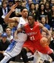 Nov 15, 2014; Durham, NC, USA; Fairfield Stags forward Amadou Sidibe (21) dribbles the ball against Duke Blue Devils center Jahlil Okafor (15) in their game at Cameron Indoor Stadium. Mandatory Credit: Mark Dolejs-USA TODAY Sports