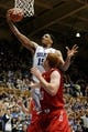 Nov 15, 2014; Durham, NC, USA; Duke Blue Devils center Jahlil Okafor (15) pulls down a rebound against Fairfield Stags forward Kevin Degnan (40) in their game at Cameron Indoor Stadium. Mandatory Credit: Mark Dolejs-USA TODAY Sports