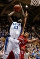 Nov 15, 2014; Durham, NC, USA; Duke Blue Devils forward Amile Jefferson (21) shoots over Fairfield Stags forward Marcus Gilbert (14) at Cameron Indoor Stadium. Mandatory Credit: Mark Dolejs-USA TODAY Sports