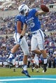 Sep 5, 2015; Colorado Springs, CO, USA; Air Force Falcons wide receiver Alex Ludowig (15) celebrates a touchdown with Air Force Falcons tight end Ryan Reffitt (85) in the third quarter against the Morgan State Bears at Falcon Stadium. The Falcons defeated the Bears 63-7. Mandatory Credit: Isaiah J. Downing-USA TODAY Sports