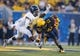 Sep 5, 2015; Morgantown, WV, USA; West Virginia Mountaineers wide receiver Jordan Thompson catches a pass across midfield during the first half against the Georgia Southern Eagles at Milan Puskar Stadium. Mandatory Credit: Ben Queen-USA TODAY Sports