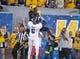 Sep 5, 2015; Morgantown, WV, USA; West Virginia Mountaineers wide receiver Jovon Durante catches a touchdown pass over Georgia Southern Eagles corner back Darrius White during the first half Milan Puskar Stadium. Mandatory Credit: Ben Queen-USA TODAY Sports