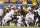 Sep 5, 2015; Morgantown, WV, USA; West Virginia Mountaineers running back Rushel Shell runs into Georgia Southern defenders during the first half at Milan Puskar Stadium. Mandatory Credit: Ben Queen-USA TODAY Sports