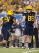 Sep 5, 2015; Morgantown, WV, USA; West Virginia Mountaineers kicker Josh Lambert celebrates with punter Nick O'Toole after making a field goal during the first half against the Georgia Southern Eagles at Milan Puskar Stadium. Mandatory Credit: Ben Queen-USA TODAY Sports
