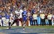 Sep 5, 2015; Gainesville, FL, USA; New Mexico State Aggies running back Larry Rose III (3) scores a touchdown against the Florida Gators during the second quarter at Ben Hill Griffin Stadium. Mandatory Credit: Kim Klement-USA TODAY Sports