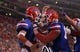 Sep 5, 2015; Gainesville, FL, USA; Florida Gators quarterback Will Grier (7) is congratulated by offensive lineman Tyler Jordan (64)  as he runs the ball in for a touchdown against the New Mexico State Aggies during the second quarter at Ben Hill Griffin Stadium. Mandatory Credit: Kim Klement-USA TODAY Sports