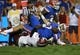 Sep 5, 2015; Gainesville, FL, USA;  New Mexico State Aggies linebacker Javahn Fergurson (7) forces Florida Gators quarterback Will Grier (7) to fumble the ball during the second quarter at Ben Hill Griffin Stadium. Mandatory Credit: Kim Klement-USA TODAY Sports