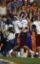 Sep 5, 2015; Gainesville, FL, USA; New Mexico State Aggies wide receiver Teldrick Morgan (1) is congratulated by quarterback Tyler Rogers (17) as he scores a touchdown against the Florida Gators during the second quarter at Ben Hill Griffin Stadium. Mandatory Credit: Kim Klement-USA TODAY Sports