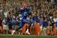 Sep 5, 2015; Gainesville, FL, USA; Florida Gators tight end C'yontai Lewis (80) runs the ball in for a touchdown against the New Mexico State Aggies during the second quarter at Ben Hill Griffin Stadium. Mandatory Credit: Kim Klement-USA TODAY Sports