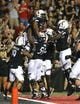 Sep 5, 2015; Cincinnati, OH, USA; Cincinnati Bearcats running back Hosey Williams (4) celebrates scoring a touchdown with teammates in the first half against the Alabama A&M Bulldogs at Nippert Stadium. Mandatory Credit: Aaron Doster-USA TODAY Sports