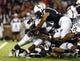 Sep 5, 2015; Cincinnati, OH, USA; Alabama A&M Bulldogs running back Byran Brower (31) is tackled by Cincinnati Bearcats linebacker Eric Wilson (23) in the first half at Nippert Stadium. Mandatory Credit: Aaron Doster-USA TODAY Sports