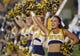 Sep 5, 2015; Morgantown, WV, USA; A West Virginia Mountaineers cheerleader is seen on the sidelines during the third quarter against the Georgia Southern Eagles at Milan Puskar Stadium.  Mandatory Credit: Ben Queen-USA TODAY Sports