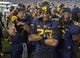 Sep 5, 2015; Morgantown, WV, USA; West Virginia players celebrate on the field after beating Georgia Southern 44-0 at Milan Puskar Stadium.  Mandatory Credit: Ben Queen-USA TODAY Sports