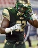 Sep 5, 2015; Tampa, FL, USA; South Florida Bulls D'Ernest Johnson (32) after a touchdown during the first  half against the Florida A & M Rattlers at Raymond James Stadium. Mandatory Credit: Jonathan Dyer-USA TODAY Sports