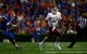 Sep 5, 2015; Gainesville, FL, USA; New Mexico State Aggies quarterback Tyler Rogers (17) runs out of the pocket against the Florida Gators during the second quarter at Ben Hill Griffin Stadium. Mandatory Credit: Kim Klement-USA TODAY Sports