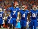 Sep 5, 2015; Gainesville, FL, USA; Florida Gators quarterback Will Grier (7) smiles with wide receiver Brandon Powell (4) against the New Mexico State Aggies during the second quarter at Ben Hill Griffin Stadium. Mandatory Credit: Kim Klement-USA TODAY Sports