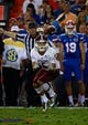 Sep 5, 2015; Gainesville, FL, USA; New Mexico State Aggies wide receiver Tyrain Taylor (5) catches the ball against the Florida Gators during the second half at Ben Hill Griffin Stadium. Mandatory Credit: Kim Klement-USA TODAY Sports