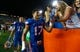 Sep 5, 2015; Gainesville, FL, USA; Florida Gators defensive lineman Jordan Sherit (17) and quarterback Anderson Proctor (17) high fives fans as they beat the New Mexico State Aggies at Ben Hill Griffin Stadium. Florida Gators defeated the New Mexico State Aggies 61-13. Mandatory Credit: Kim Klement-USA TODAY Sports