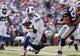 Sep 20, 2015; Orchard Park, NY, USA; New England Patriots defensive end Chandler Jones (95) tackles Buffalo Bills quarterback Tyrod Taylor (5) during the first half at Ralph Wilson Stadium. Mandatory Credit: Kevin Hoffman-USA TODAY Sports